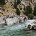 A visitor preparing to make a splash in the cold water of the Payette River- Kirkham Hot Springs