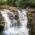 Jumping from the far boulder is not so easily done!- Ho'opi'i Upper Falls