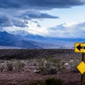 Storm clouds race over taller peaks in the outskirts of the park.- A Mountain Brat in Death Valley