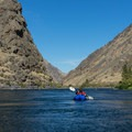 Packrafter in Hells Canyon of the Snake River.- 5 Trending Adventures to Try in 2019