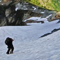 Last push up the snowfield before finding ourselves on a loose, rocky climb.- Embracing the Struggle