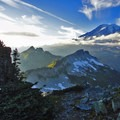 The sun begins to set in the Tatoosh Range overlooking Mount Rainier.- Embracing the Struggle