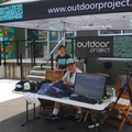 Outdoor Project's Brian Haber and Anzelina Coodey manning the tent.- Summer Solstice Block Party - A Recap