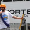 Rare Earth Adventure's Travis Mazingo on stage.- Summer Solstice Block Party - A Recap