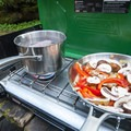 If your campground doesn't have campfire grills, a good 2-burner camp stove comes in handy.- Glamp Vibes