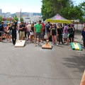 Folks enjoy a game of corn hole.- Summer Solstice Block Party - A Recap