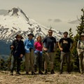 The full group posing for a photo under Mount Hood from Lookout Mountain's summit.- Exploring Lookout Mountain with Oregon Wild