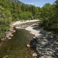 The South Fork of the Snoqualmie River at Homestead Valley Road Bridge.- Seattle's 20 Best Beaches + Swimming Holes