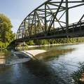 View of the Highway 203 bridge over the Skykomish River at Al Borlin Park.- Seattle's 20 Best Beaches + Swimming Holes