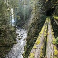 South Fork Clackamas Falls visible just past the old bridge and chasm.- 3 Hikes = 5 Waterfalls You've Never Heard Of