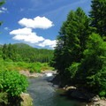 View of the Wilson River with Kings Mountain in the distance.- Meet the Wild Salmon Center