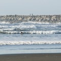 Surfers out at Westhaven State Park beach and jetty.- Washington's 20 Best Beaches