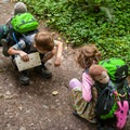 Stopping to look at black slugs on the Hoh River trail in Olympic National Park.- The Basics of Backpacking with Kids