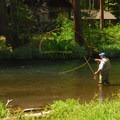Fisherman on the Metolius River outside of Smiling River Campground.- Camping on the Metolius River