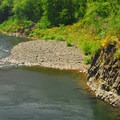 View of the Wilson River's best cliff jumping spot at the Cedar Butte Road Bridge.- Summer Along the Wilson River