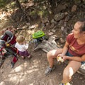 Taking a break on the Fowler Trail in Eldorado Canyon State Park outside of Boulder, Colorado.- Gear Review: Deuter Kid Comfort 2