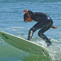 A youngster ripping waves at Opal Cliffs/Pleasure Point.- 5 Great Ways to Explore Santa Cruz