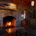 A historic stone fireplace.- Great Lodges of the West