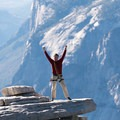 The hero shot available to successful Half Dome climbers, perched on The Visor thousands of feet above the valley floor. El Capitan is clearly visible in the background.- Climbing Half Dome In The Shoulder Season