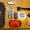 If I am doing a backpacking trip, I add these items: A) Portable camping chair B) Cell phone charger C) Small Mag light for light painting D) Medicine for various ailments E) Backpackers air pillow F) Ultralight lantern G) Sleeping bag liner H) Bear mace- What's in My Pack: Photographer Edition