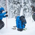 Probing to find the precise location of the buried beacon.- Welcome Winter with an Avalanche Awareness Course