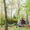 Hammock time at Jb Trading Co. Camp, Arkansas (available this weekend). Photo by Michelle Park via Hipcamp.- Your Guide to Last-Minute Camping
