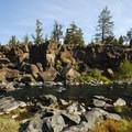 Basalt rim along the Deschutes River in Sawyer Park.- Volcanism, The Defining Feature of the Pacific Northwest