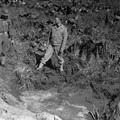 US Soldiers inspecting crater caused by Japanese shelling.  June 1942.- Columbia River Harbor Defense System