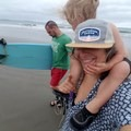 Family surfing.- Woman In The Wild: Justine Nobbe