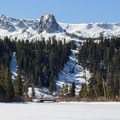 Tamarack Lodge is located in the Mammoth Lakes Basin above the town of Mammoth Lakes. The front yard view looks over Twin Lakes and the Mammoth Crest.- Tamarack Lodge