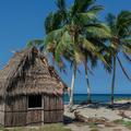 Garifuna village hut.- The Transformative Experience of Traveling Alone