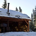 Gold Lake Shelter on a clear day.- It's Cold! Explore These 8 Winter Adventures with Warming Huts