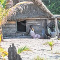 Garifuna woman on her porch.- The Transformative Experience of Traveling Alone