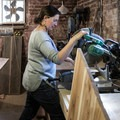 Heather using her saw to work on a custom furniture piece in Denver. Photo by Maliha Mannan.- Woman In The Wild: Heather Mullins
