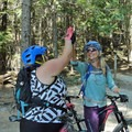 Lindsey high-fives Ashley after she accomplishes more than she thought possible on her bike. Photo by Doug Jambor.- Woman In The Wild: Lindsey Richter