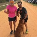 """Running on my favorite 10-mile loop in Florida with my training partner Dave Burger and his dog, Dax. We ran two loops totaling 20 miles, and so did his dog!!""- Woman In The Wild: Lisa Bentley"