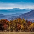 Visit the North Carolina side of the Smokies and Gooseberry Knob at The Swag to soak up this view. You can stay at The Swag or dine there or hike there via trails in the Great Smoky Mountains. - A Guide to Leaf-peeping Weekends in the Blue Ridge Mountains