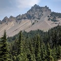 The trail to Three Fingered Jack's summit is visible through the scree.- Summit Trips Along the Pacific Crest Trail