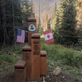 Pacific Crest Trail monument: the northern end of a West Coast journey.- Summit Trips Along the Pacific Crest Trail