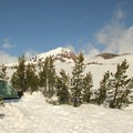 A tent nestled into a patch of trees at timberline to help as a wind break- An Intro to Snow Camping