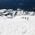 Skiers and climbers make their way up.- Climbing Mount St. Helens for Moms