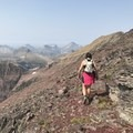 "I am a firm believer that scrambling along a ridgeline is about the most fun you can have without snow on the ground. Here, I ""run"" along a ridgeline in Glacier National Park. Photo by Jordan Smith.- Woman In The Wild: Emily Downing"