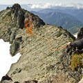 Setting up the rappel from the summit of Unicorn Peak.- Embracing the Struggle