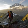 Outdoor Project Contributor Josh Lupkin, silhouetted against the view of Mount Rainier in the distance.- Embracing the Struggle