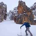 Scoping out the Grand Daddy Couloir on the skin up.- How to Get Into Backcountry Skiing + Boarding