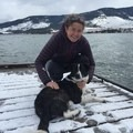 My dog Lottie is terrified of docks (and she's not much of a swimmer, either). In order to reach me at the end of this dock, also on Flathead Lake, she belly crawled through the fresh snow so she wouldn't fall off the dock. Photo by Betsy Odell.- Woman In The Wild: Emily Downing