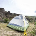 3-aluminum alloy poles, stakes, and a durable poly tent.- Mountainsmith Morrison Evo 2