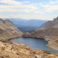 Columbine Lake from Sawtooth Pass (11,630') in Sequoia National Park. Mount Whitney (14,505') is the high point on the farthest ridge left.- California: Your Next Destination for Adventure