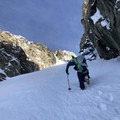 Bootpacking with skis on the skimo carry.- Gear Review: Ultimate Direction Skimo Adventure Vest