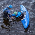 Kayakers practice their rolls on the Black River in Watertown.- Relicensing the Black River Basin